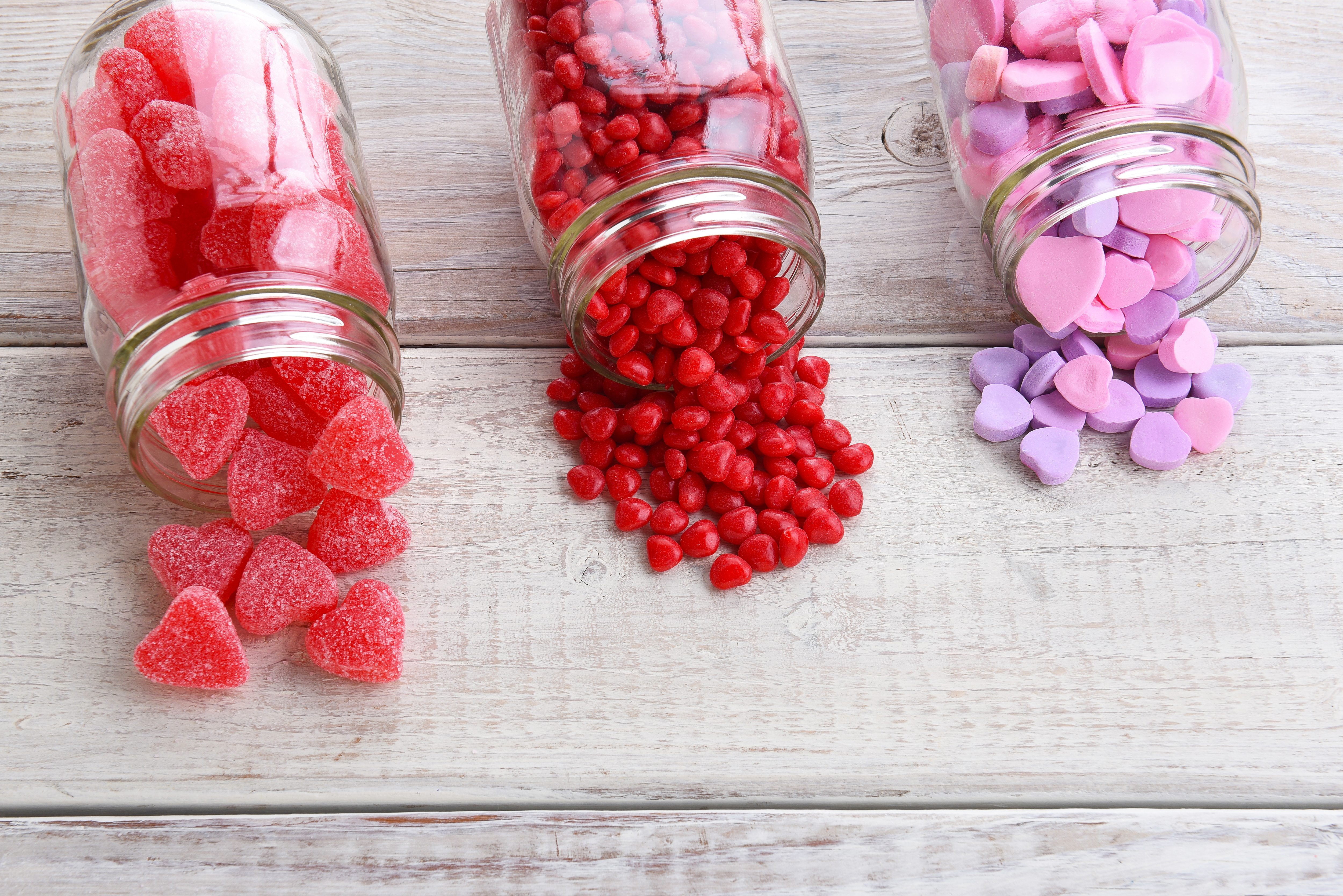 three jars of sweets- health and well-being sector